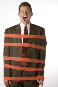 Businessman tied up in red tape